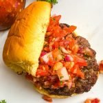 grilled burger with a relish made from fresh tomatoes