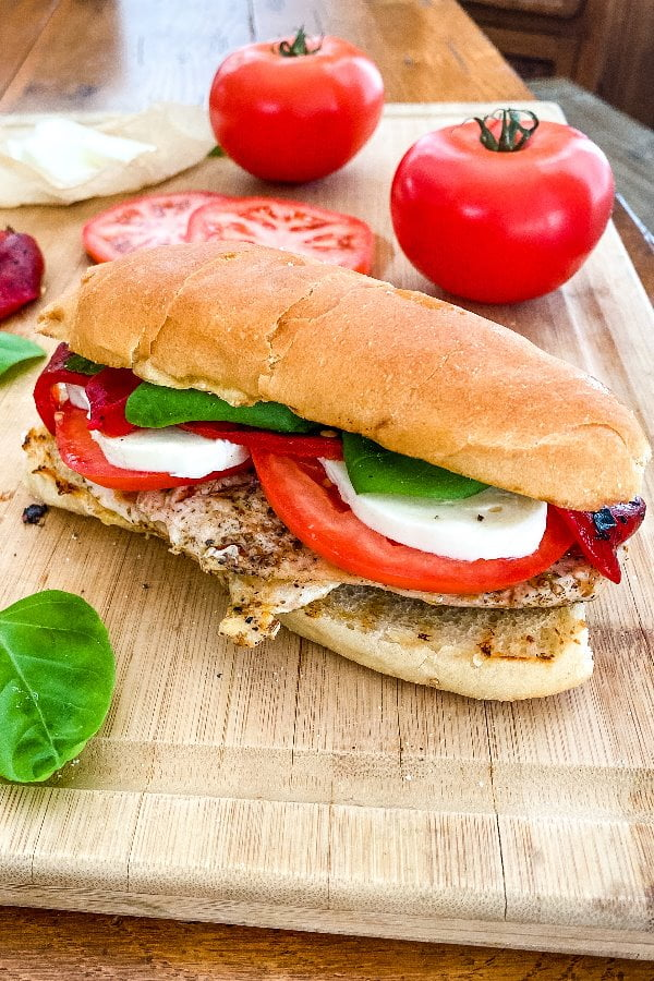 sandwich with grilled chicken, fresh mozzarella, and tomatoes