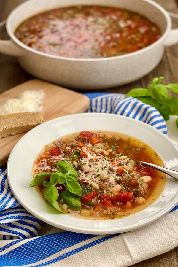 bowl of pasta soup with Italian sausage and vegetables
