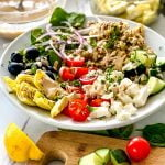 quinoa bowls with artichokes, olives, feta and tahini dressing