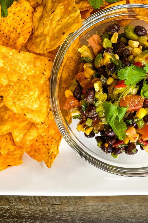 bowl of Tex-Mex bean dip with tortilla chips