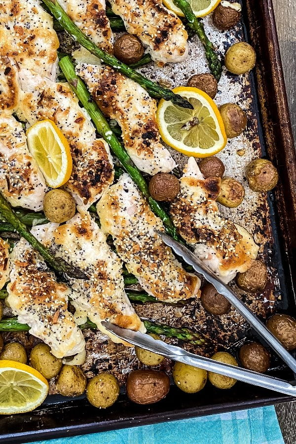 cooked sheet pan dinner with poultry, asparagus and potatoes