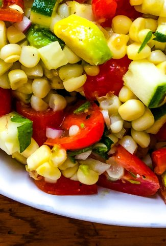summer salad with corn and avocado and a sherry vinaigrette