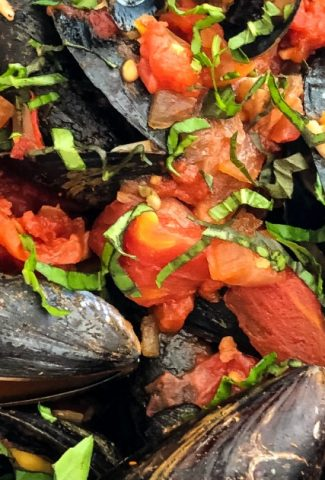mussels cooked in a light marinara sauce