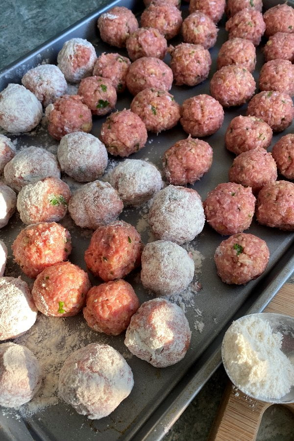 meatballs rolled in flour before frying