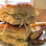 2 creamy artichoke dip turkey sliders stacked on top of each other