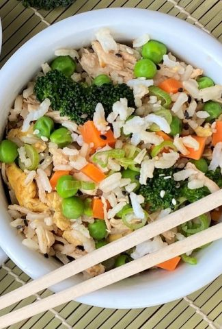 bowl of fried rice with chicken and broccoli