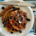 plate of blueberry bread pudding pancakes