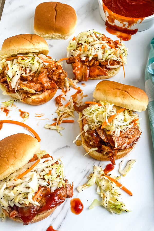 platter of barbecue pork sliders with cole slaw