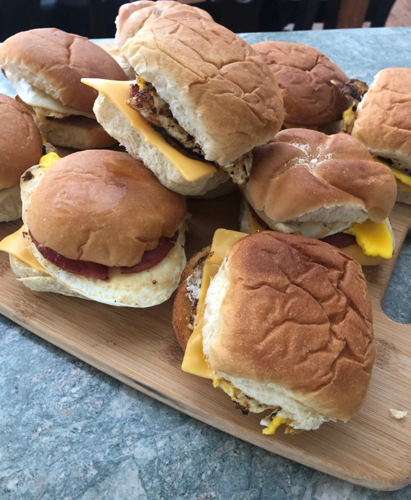 pile of pork roll, egg and cheese breakfast sandwiches