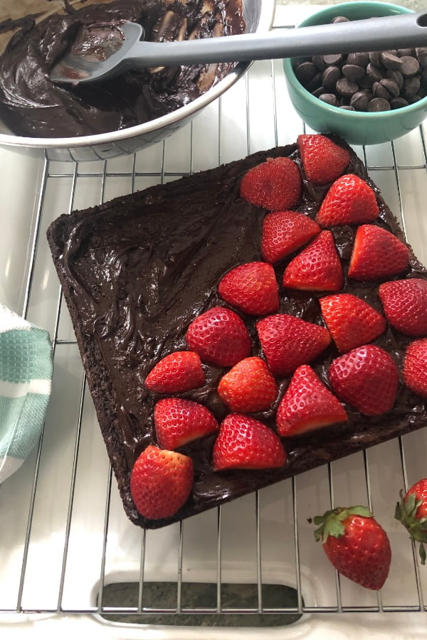 decadent chocolate ganache holds the strawberries in place on top of the chocolate bars