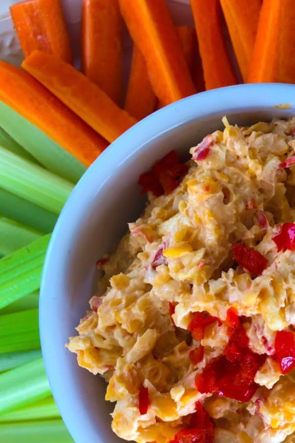 cheese spread with carrots and celery sticks