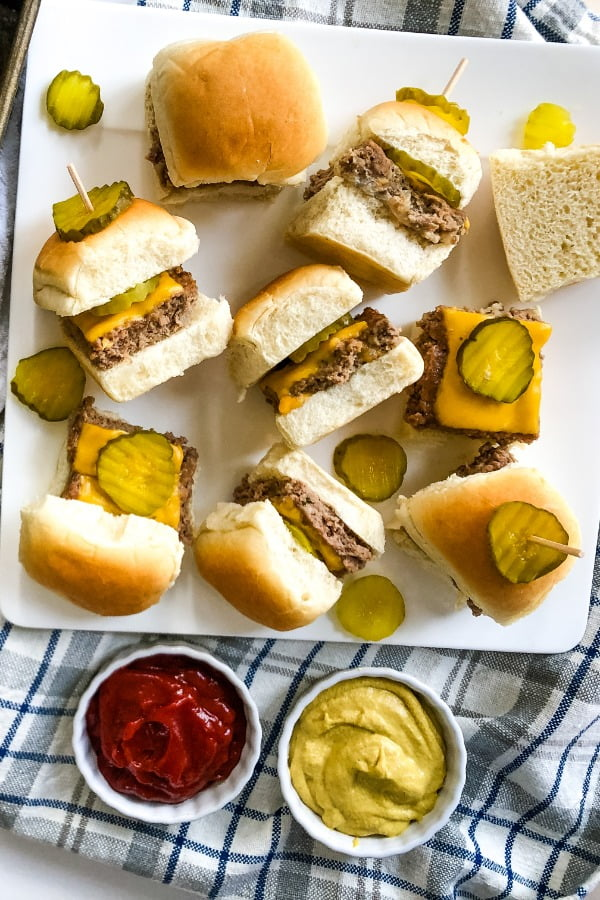 cheeseburger sliders recipe for a plate with 8 sliders with dill pickle chips