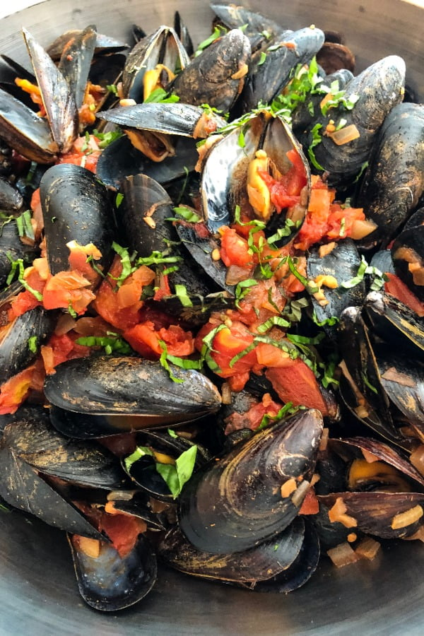 family style bowl of mussels marinara