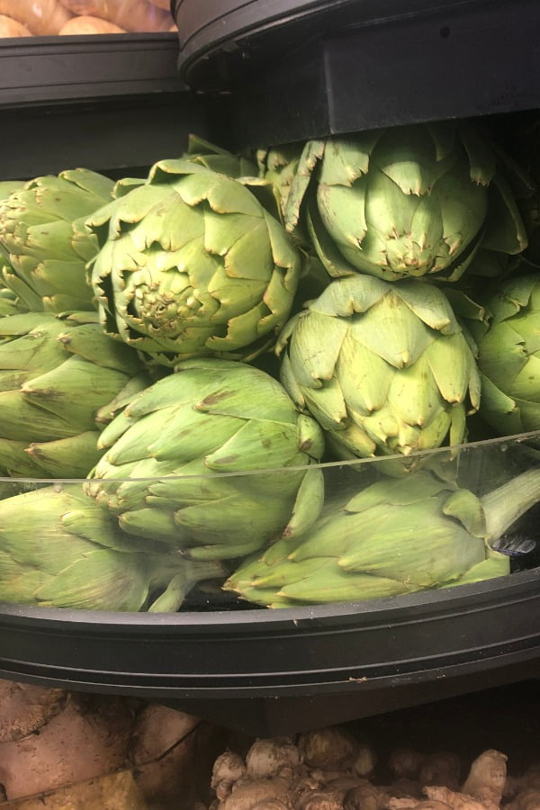 bin or artichokes at grocery store