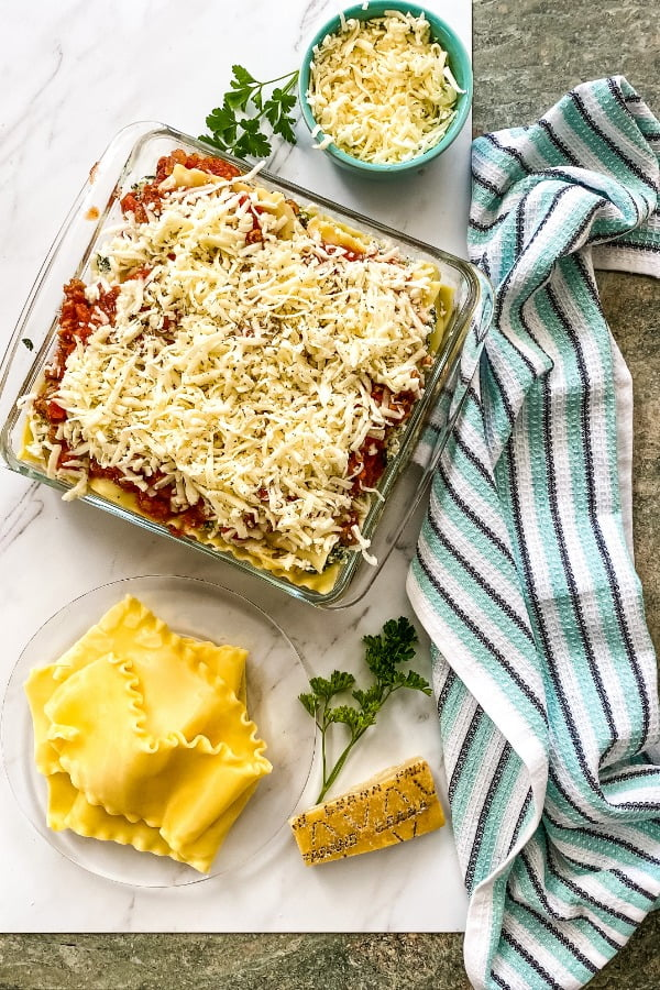 an assembled and unbaked layered Italian pasta dish