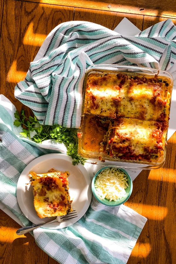 baked lasagna with 1 piece removed