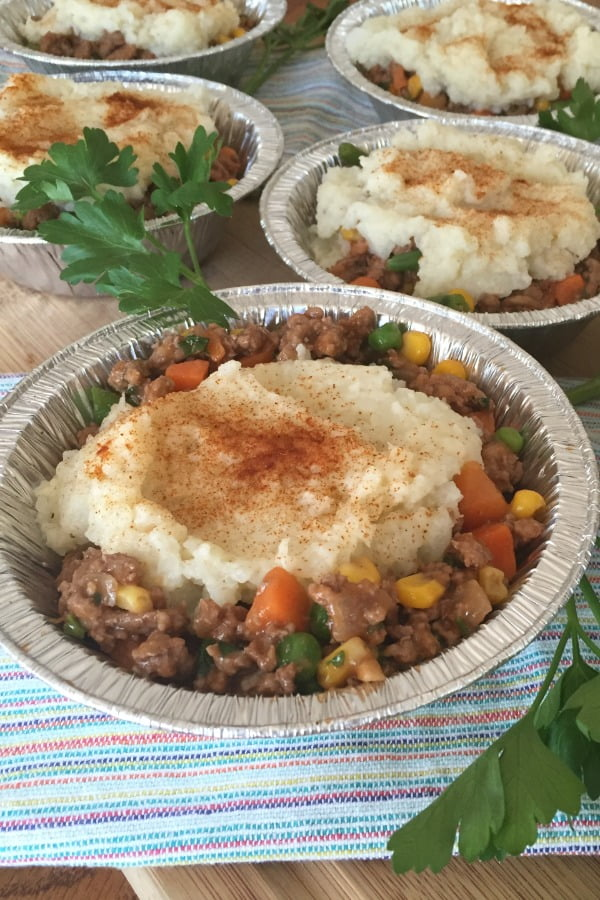 individual servings of shepherd's pies with cauliflower topping and a ground turkey and vegetable filling