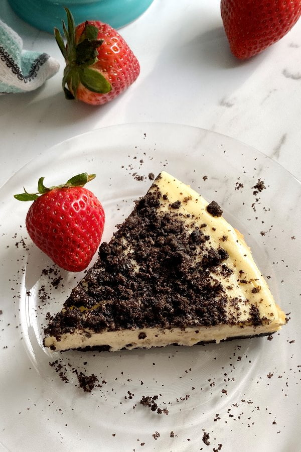 slice of Oreo cheesecake with strawberries