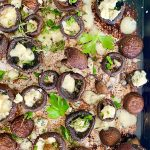 pan of baked mushrooms with butter, garlic and blue cheese