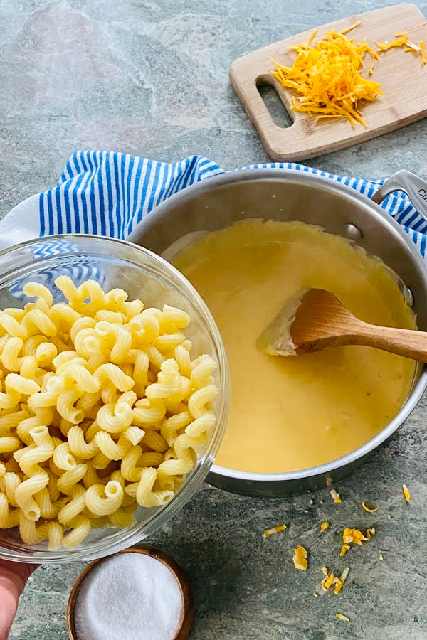 cooked pasta and cheese sauce for mac and cheese