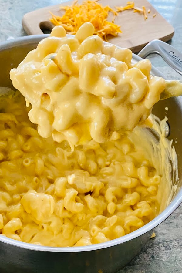 big spoonful of super cheesy mac and cheese