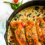 skillet with baked salmon in a coconut sauce - personal chef recipe
