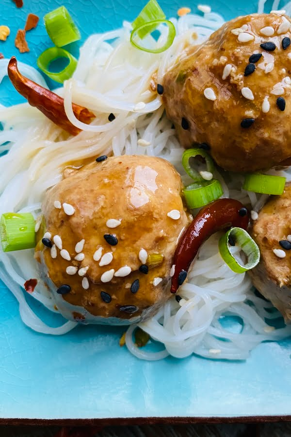 close up of General Tso's spicy meatballs with dried red chilies