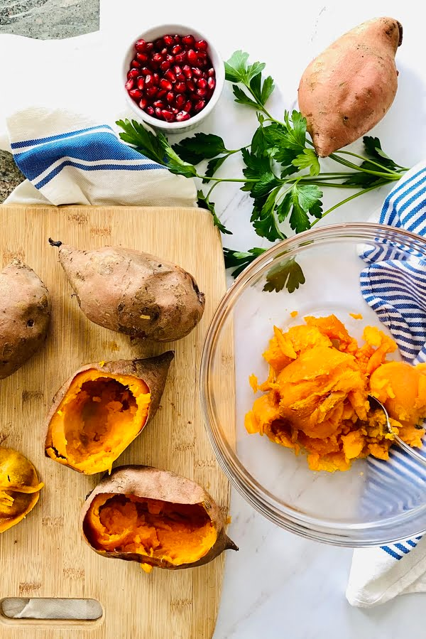 sweet potato skins and a bowl with mashed sweet potato