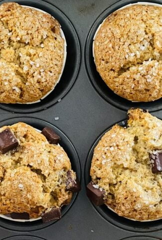 muffin pan with 7 banana bread muffins