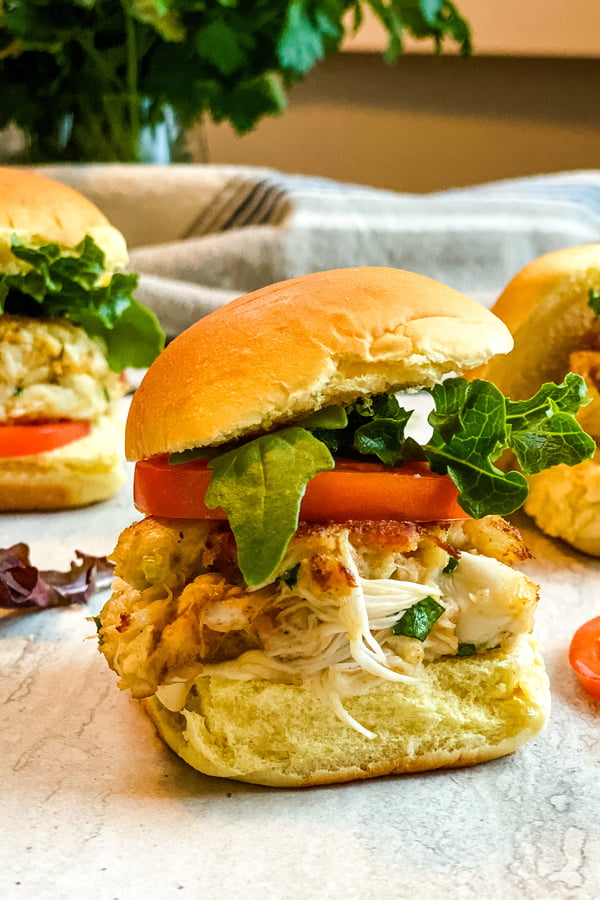 mini crab cake sandwiches with bacon, lettuce and tomato