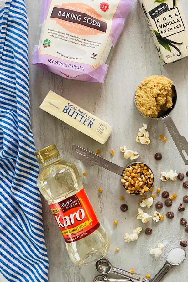 the ingredients for caramel corn - popcorn, brown sugar, butter
