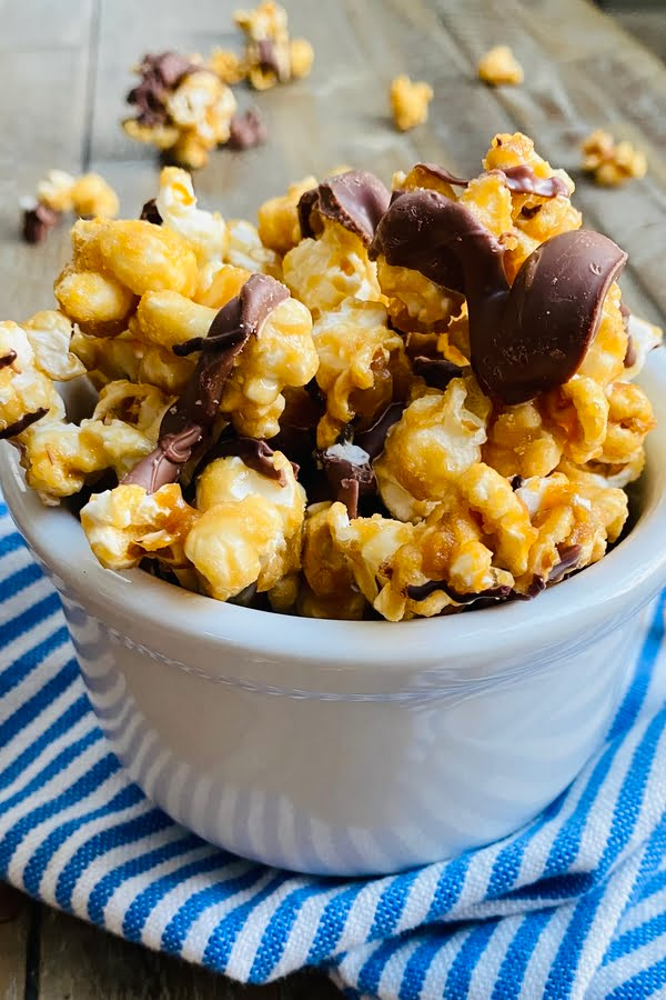 bowl of salted caramel popcorn with chocolate drizzle