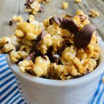 sugary popped corn with chocolate drizzle