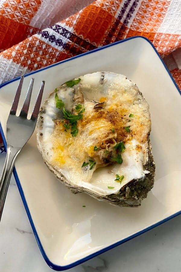 baked oysters with creole seasoning and melted cheese