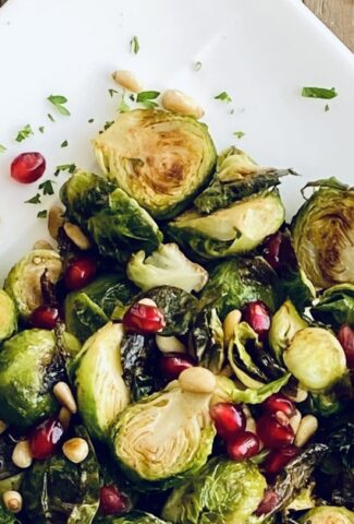 platter of roasted Brussels sprouts with pomegranate and pine nuts