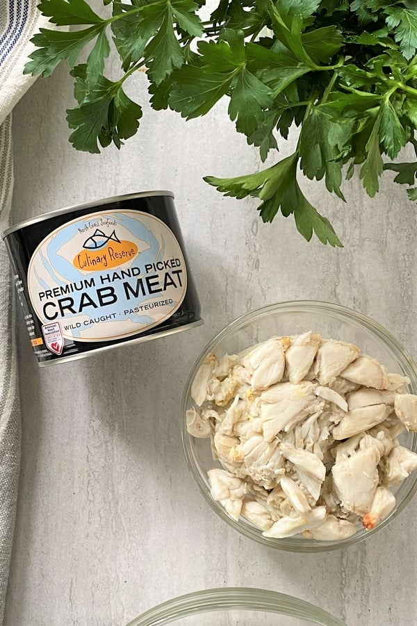 can of crab meat and a bowl of crab meat