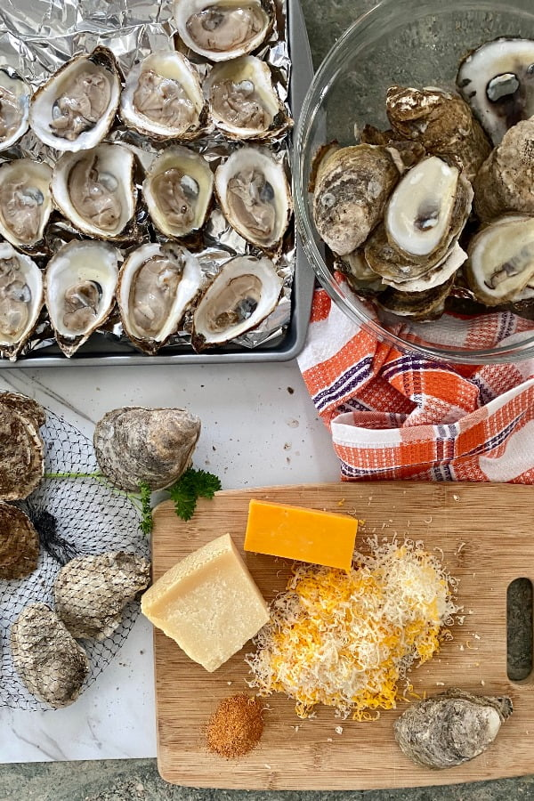 shucked oysters, shredded Parmesan and cheddar cheese