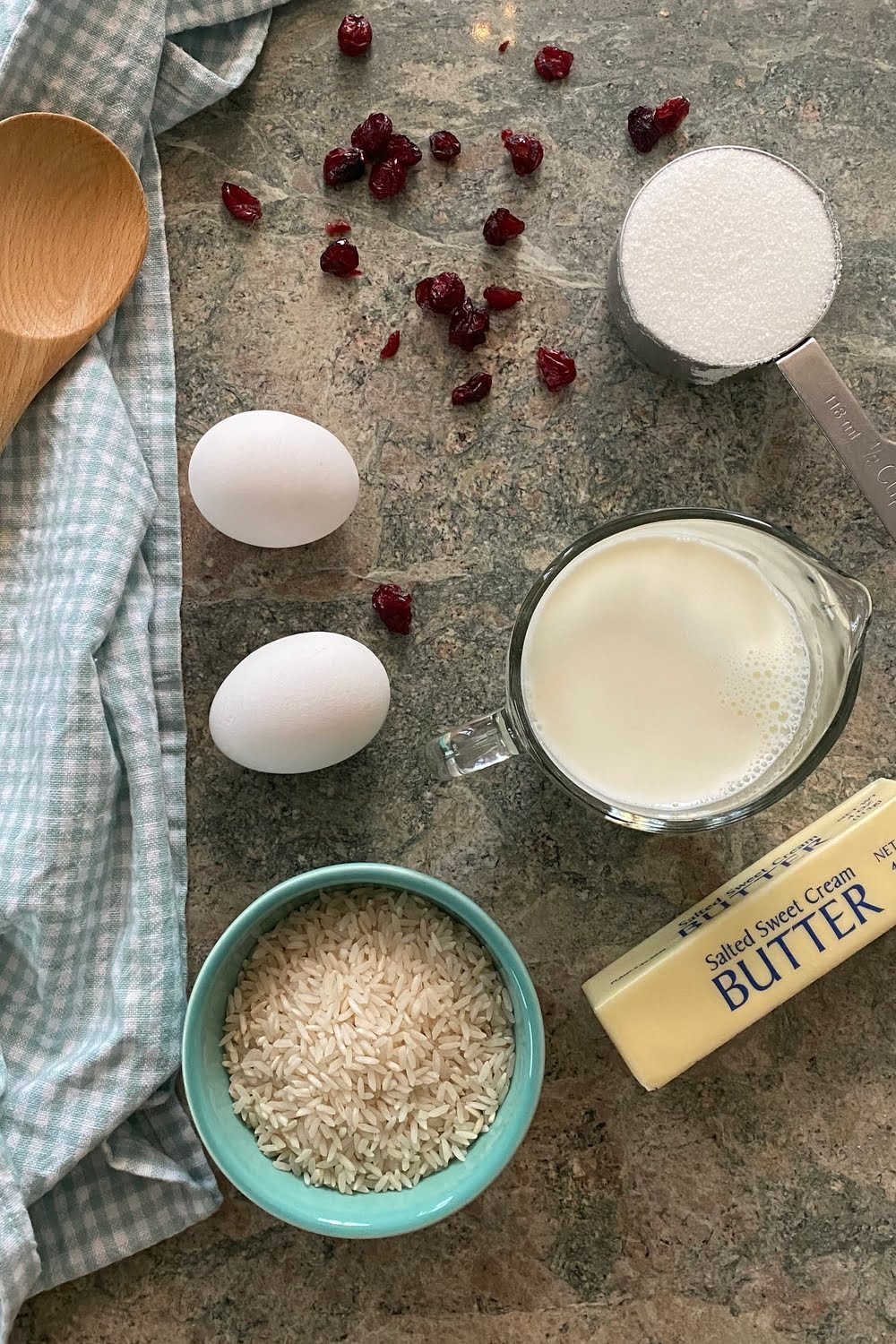 grain, whole milk, butter, eggs, sugar and dried cranberries for creamy dessert
